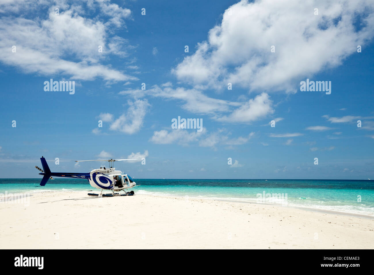 Helicopter on Vlassof Cay - a sand cay off the coast of Cairns. Great Barrier Reef Marine Park, Queensland, Australia - Stock Image