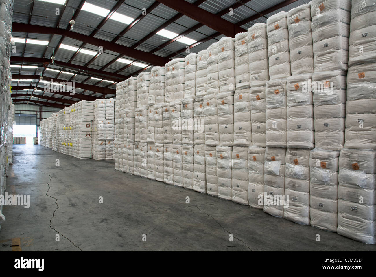 Agriculture - Cotton bales stacked and stored in a warehouse / Eastern Arkansas, USA. - Stock Image