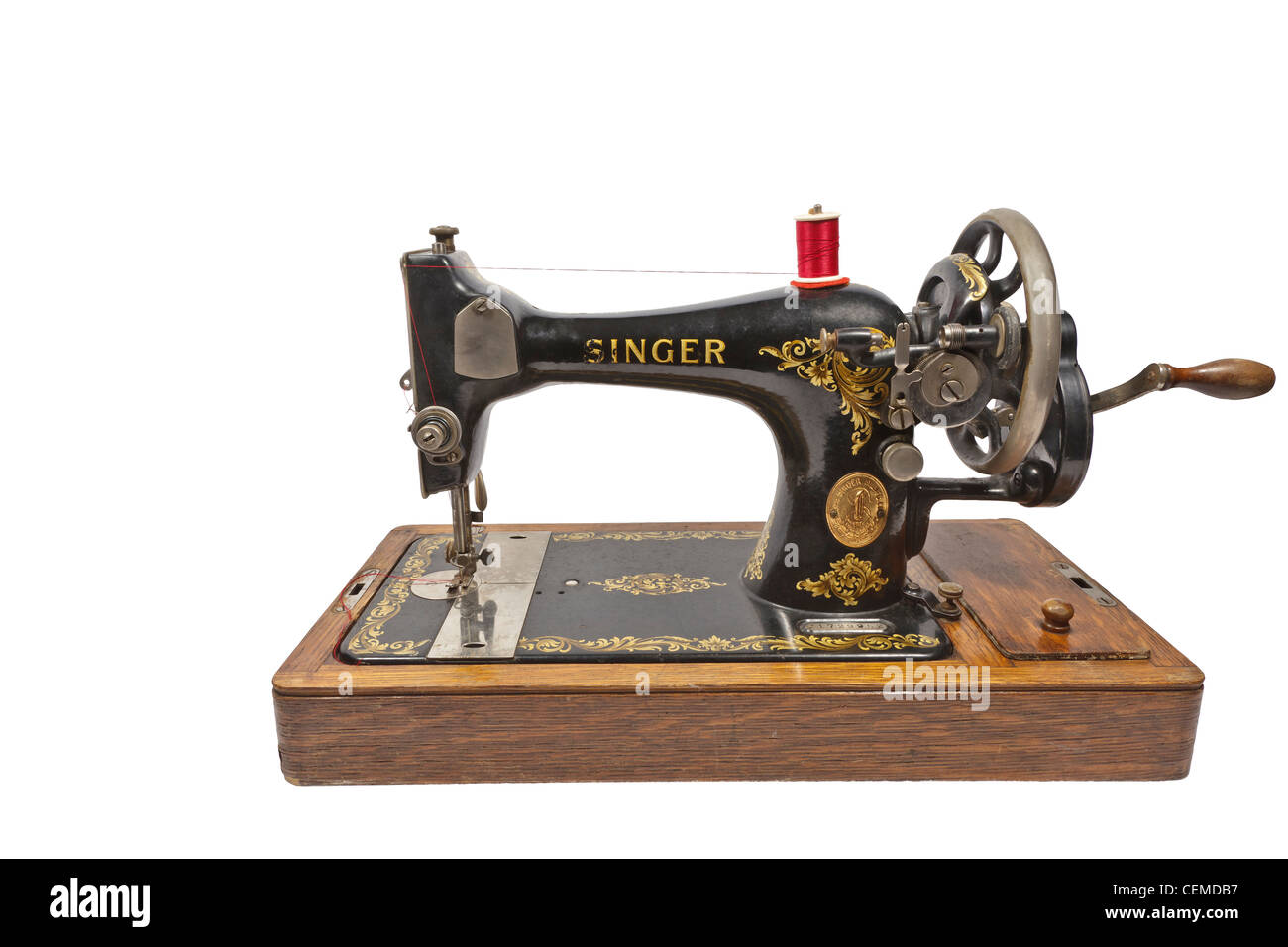 old fashioned  hand cranked sewing machine - Stock Image