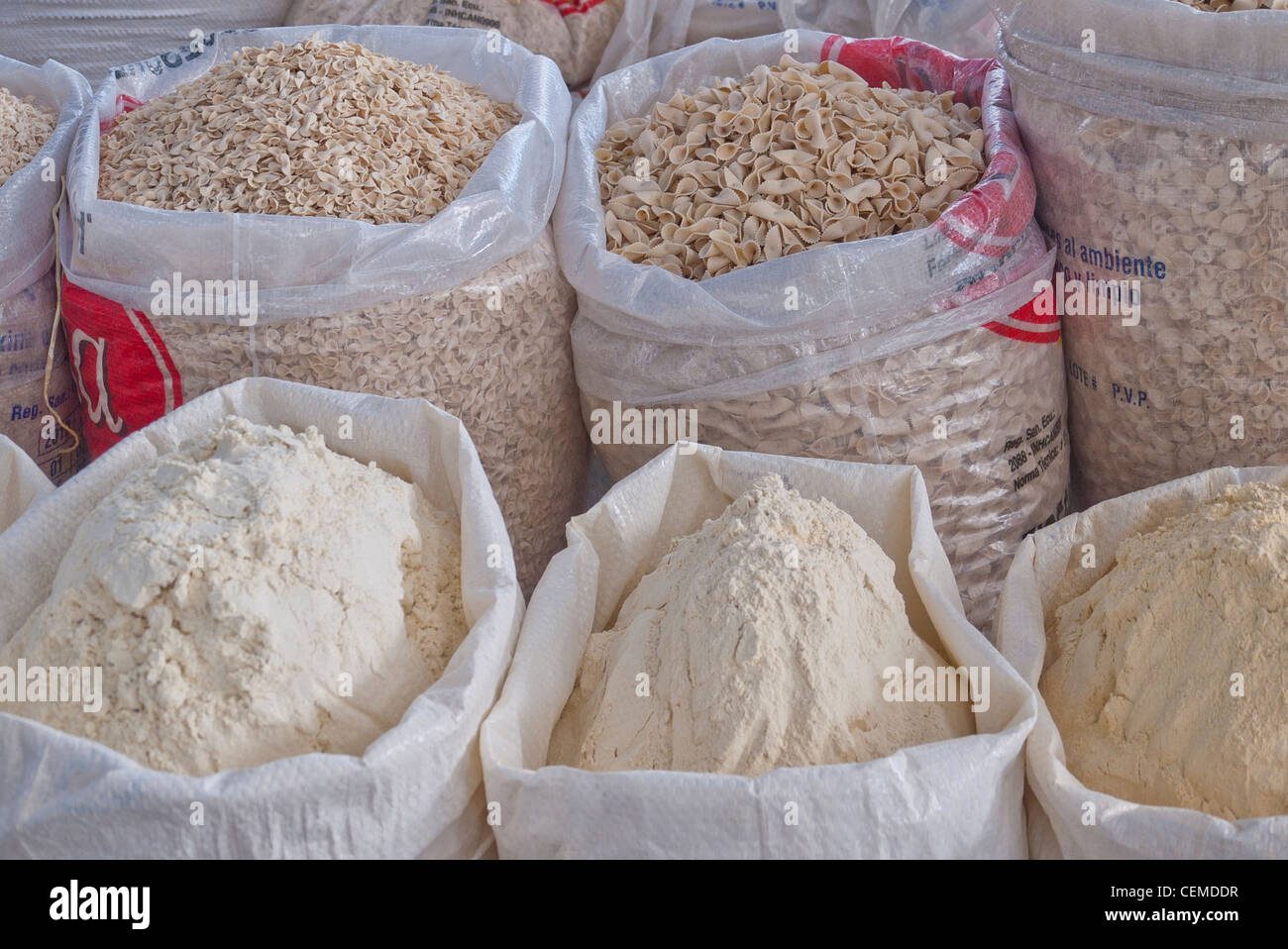 Open sacks of grains are on display for sale at the public market in Pujili, Ecuador. - Stock Image
