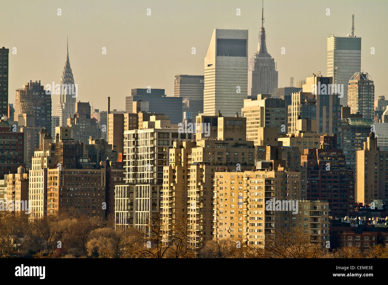 a photo taken from the RFK bridge of a part of the manhattan skyline at dawn. - Stock Image
