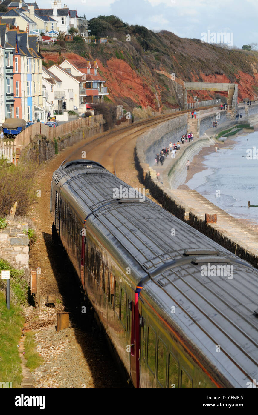First Great Western HST train passes along the sea wall at Dawlish - Stock Image
