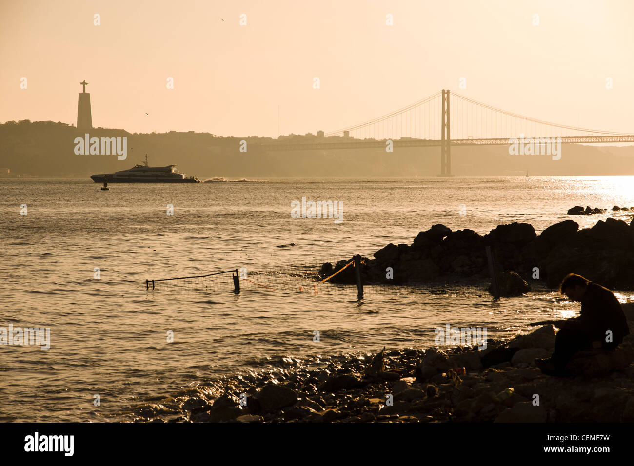 Man at the Tagus riverbank. Lisbon, Portugal. - Stock Image