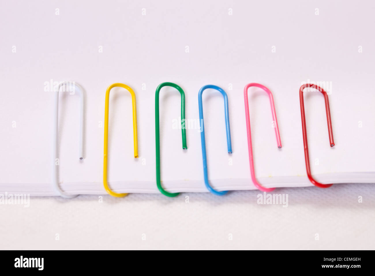 multi colored paper clips,office supplies,stationary - Stock Image