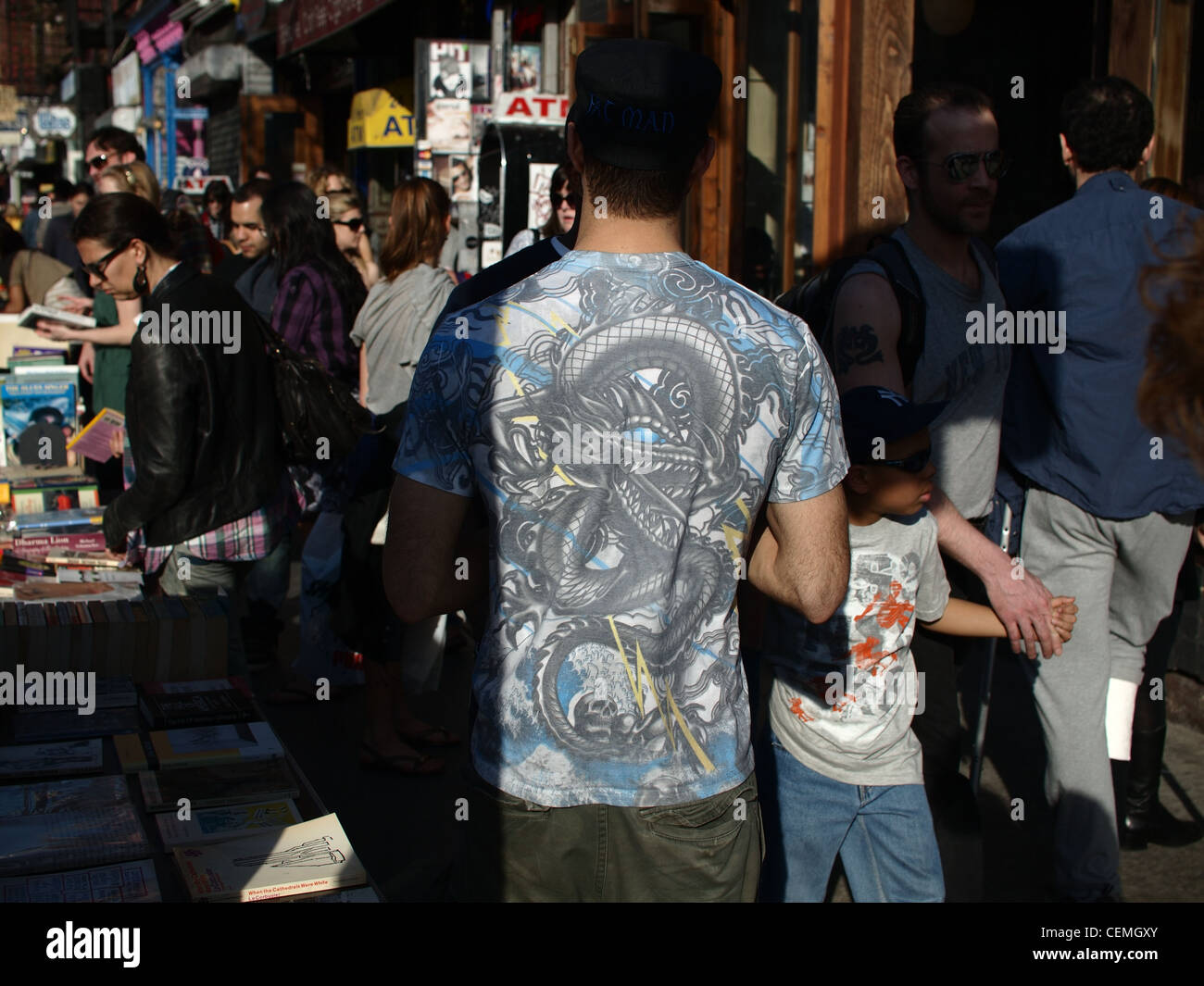 0affd871a Man wearing colorful t-shirt in crowd on street, Brooklyn, New York -