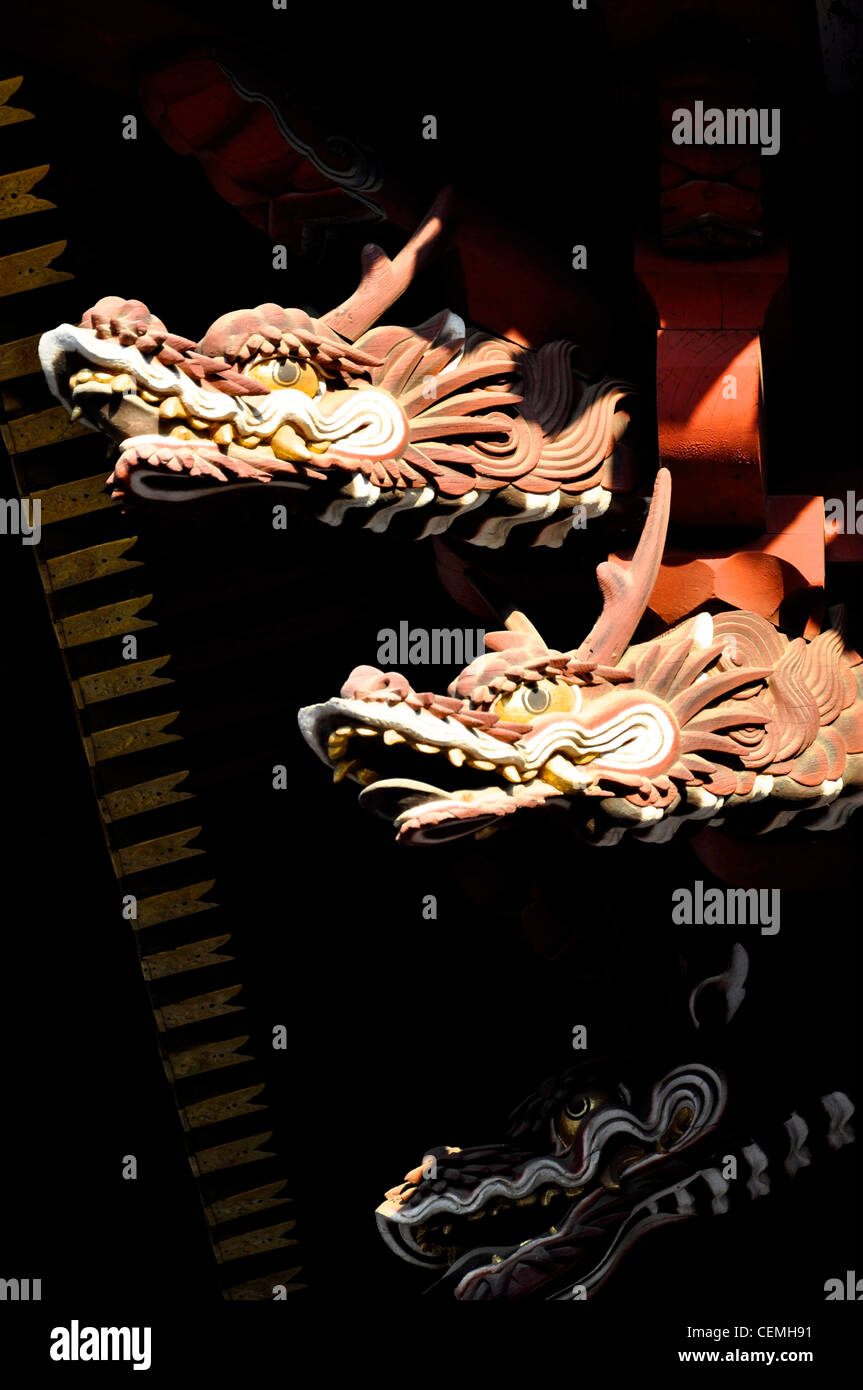 Carved wooden dragons emerging from the darkness in a Japanese Temple. Stock Photo
