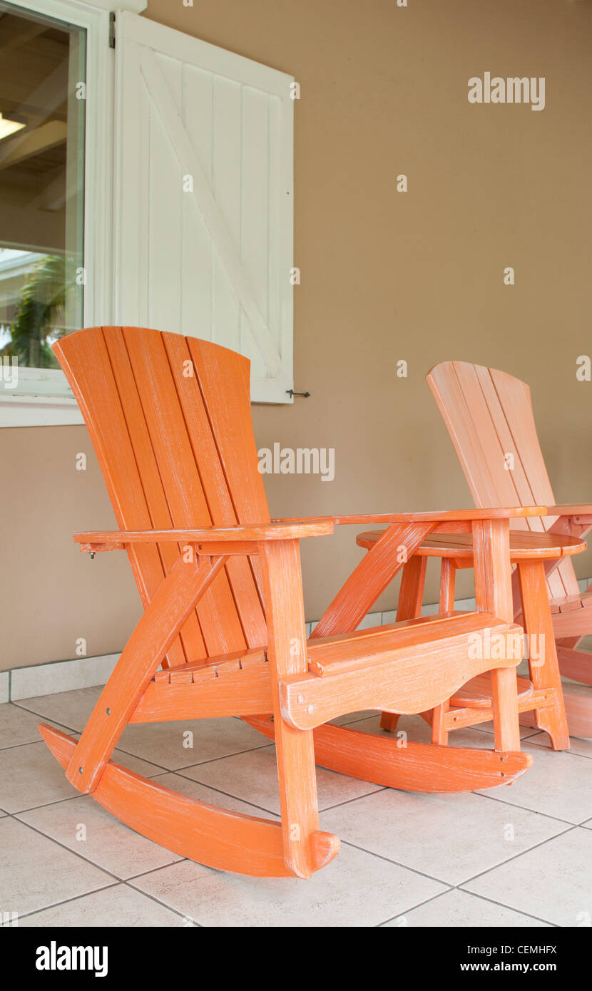 Marvelous Orange And Pink Wooden Rocking Chairs On A Porch Usual Ibusinesslaw Wood Chair Design Ideas Ibusinesslaworg