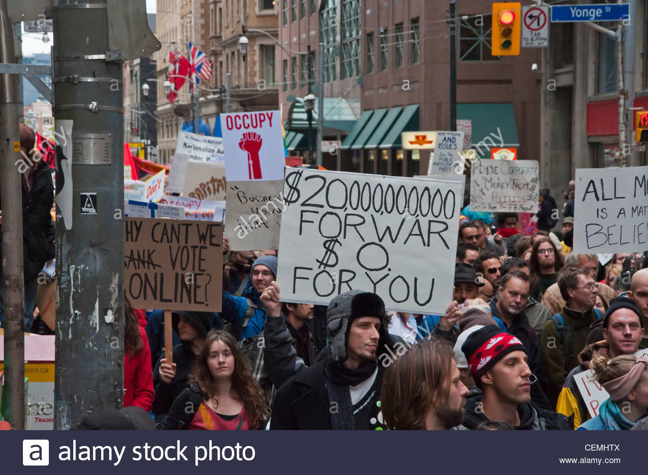 Thousands of people protesting against neo-liberalism in Toronto,Canada. Strong anti-war message. - Stock Image