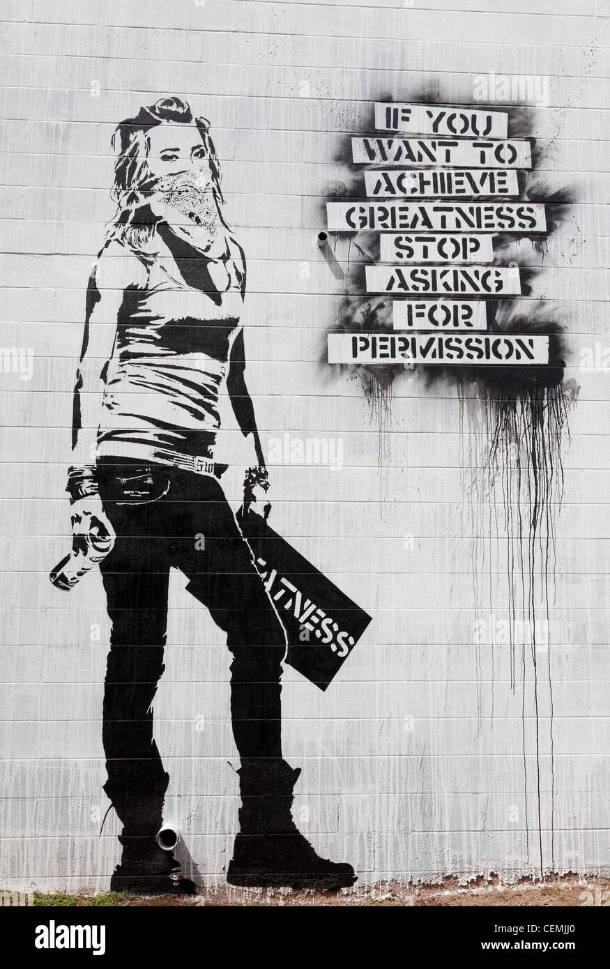 Contemporary street art, If you want to achieve greatness stop asking for permission - Stock Image