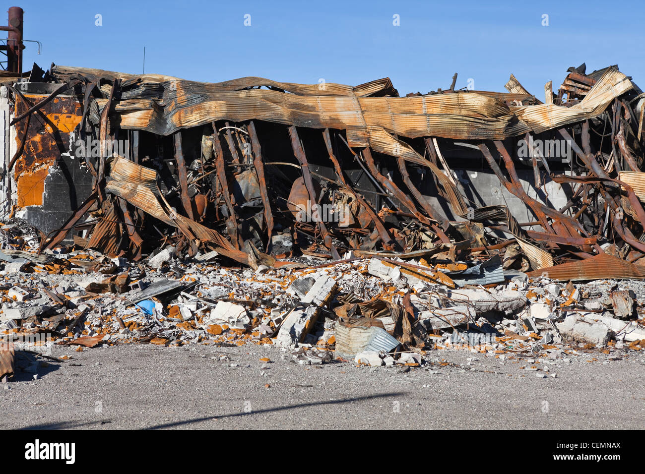 Melted ruin of a fire damaged structure. - Stock Image