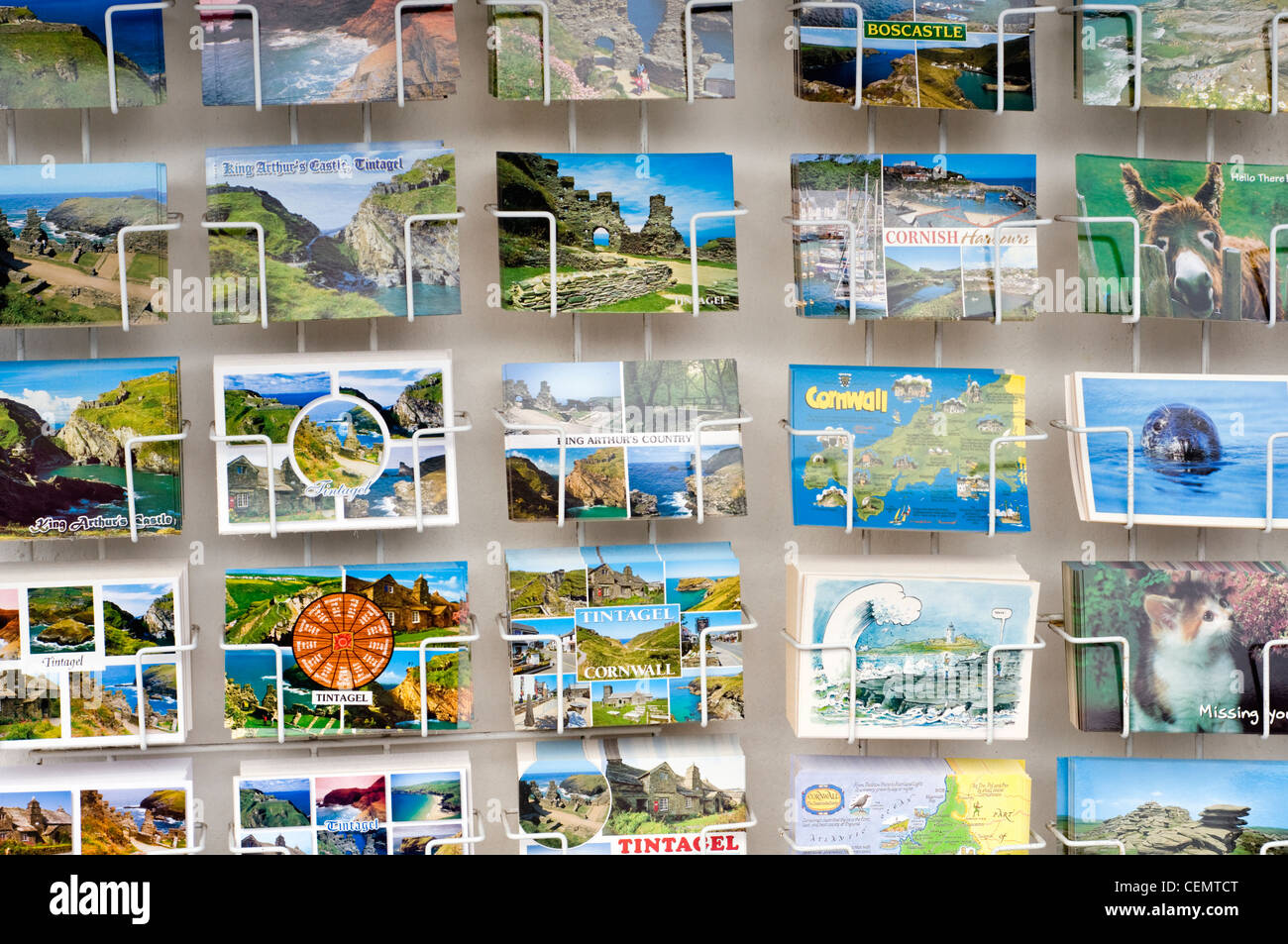 Postcards for sale outside a shop in Tintagel, Cornwall, England, UK - Stock Image
