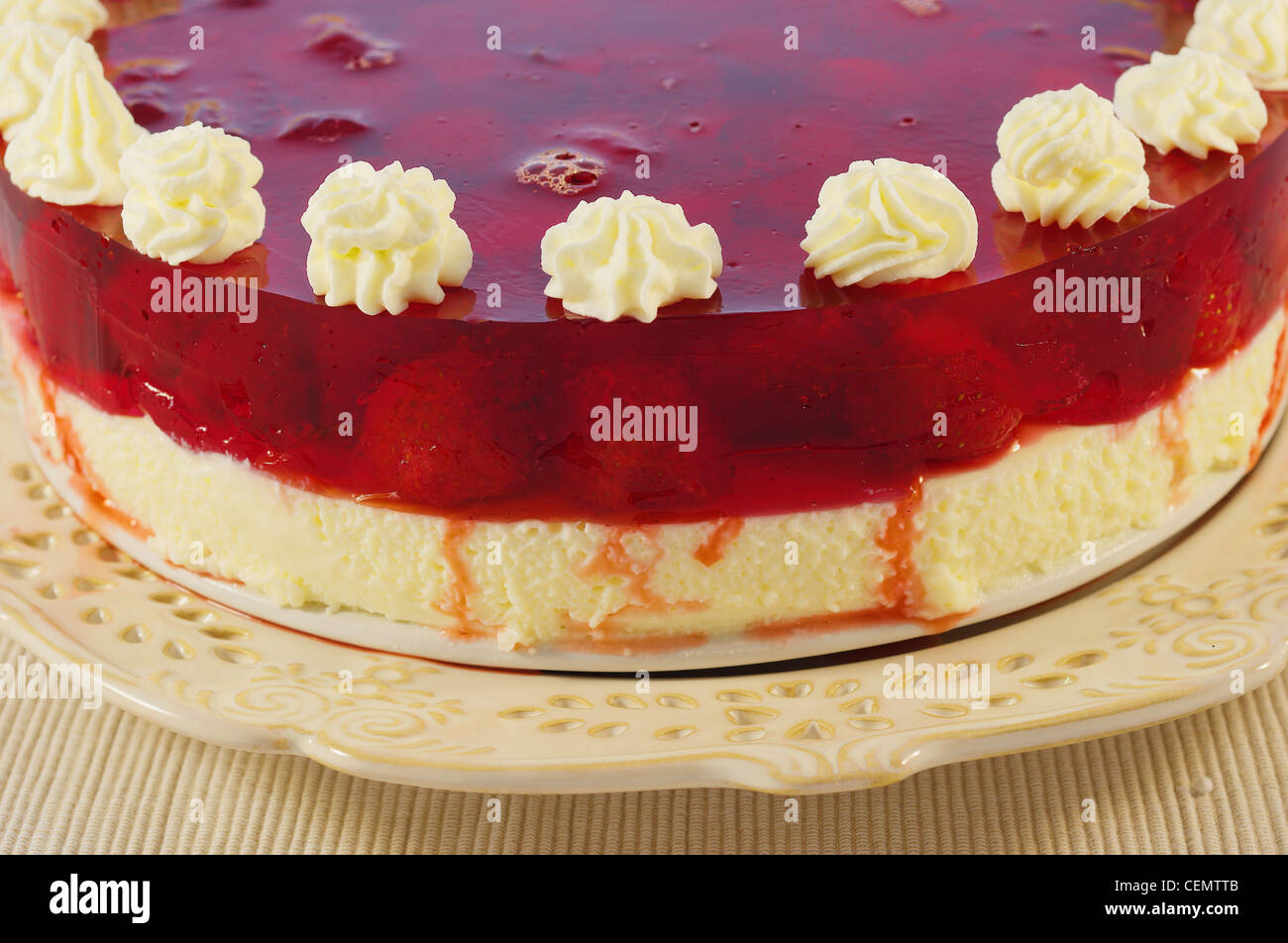 Cheesecake with strawberries in a strawberry jelly - Stock Image