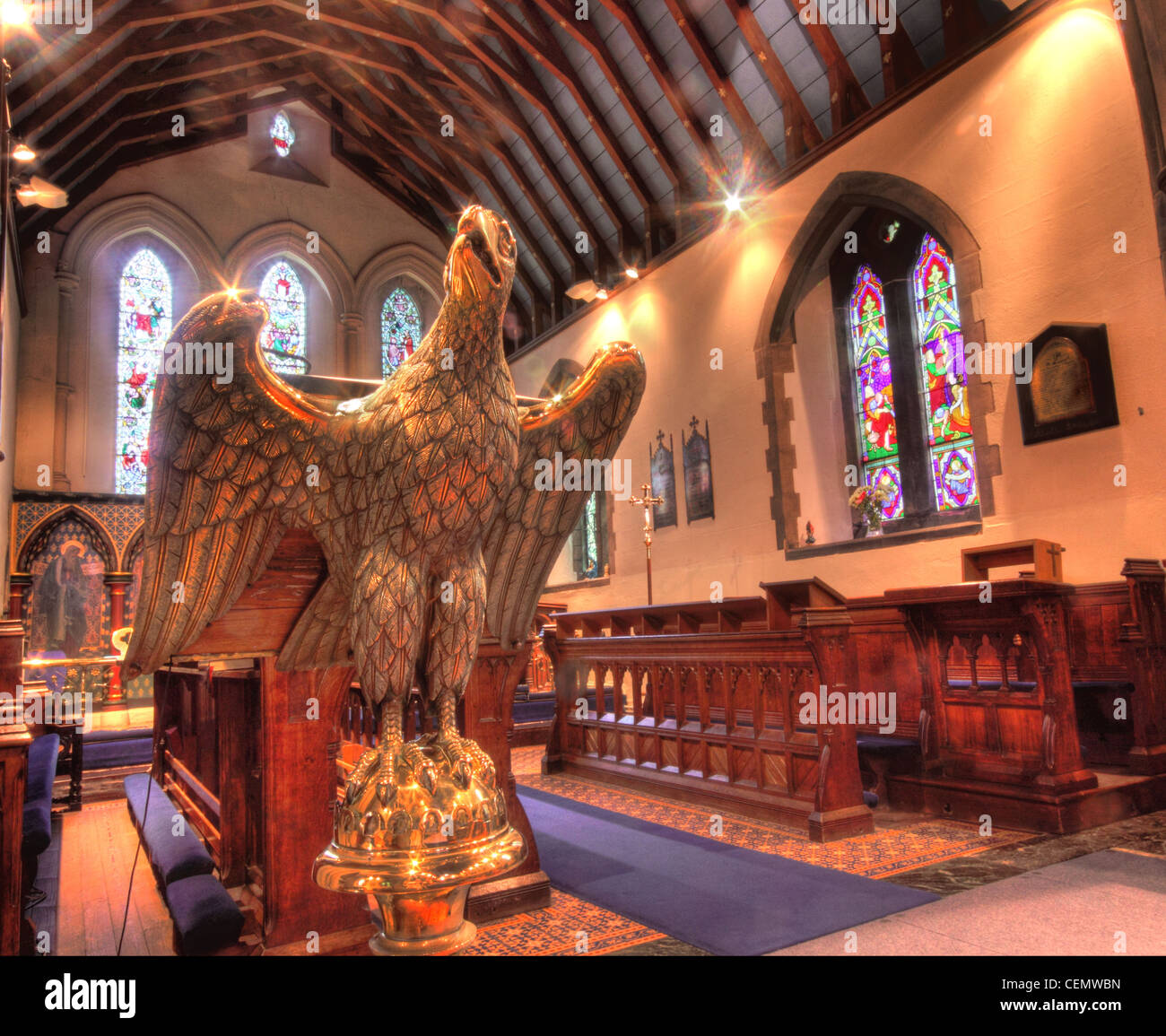 All Saints Church Thelwall, South Warrington, Cheshire England UK United Kingdom. Anglican Religion Brass eagle Stock Photo