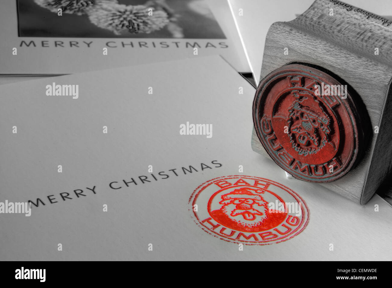 Bah Humbug to Christmas Anti-Xmas stamp in red on a card - Stock Image