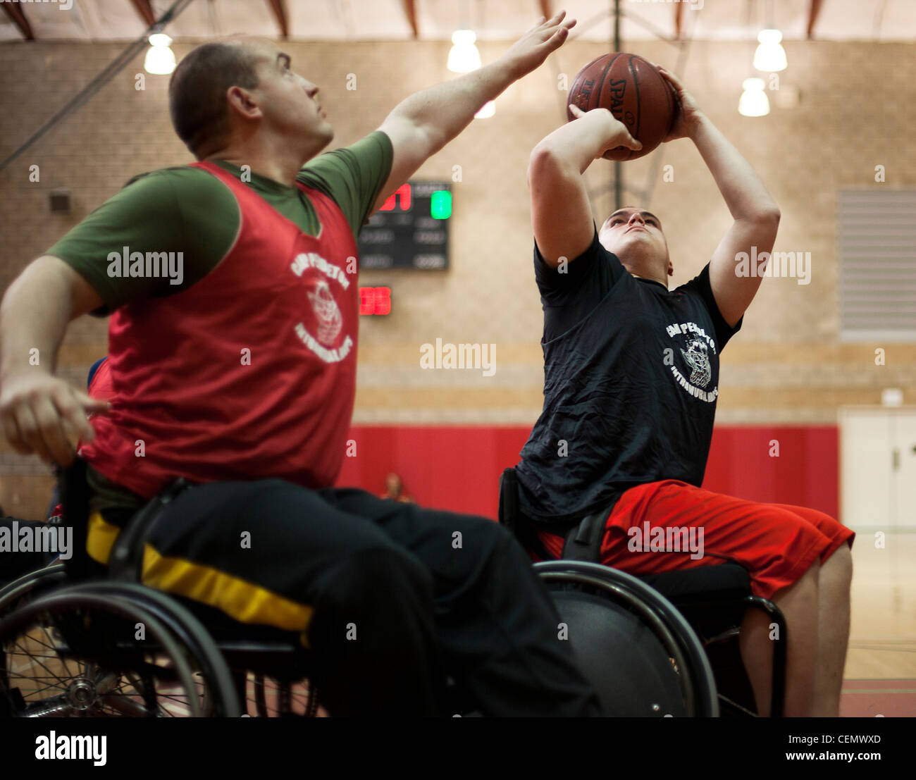 Lance Cpl. Zach Blair, a Wounded Warrior with the West Team, takes a shot during a playoff game at the 2012 Marine - Stock Image
