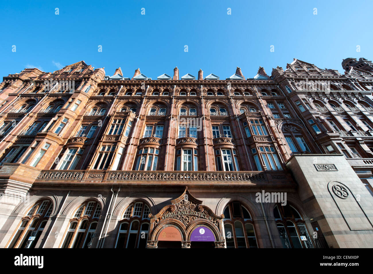 The Midland Hotel in Manchester City Centre on a clear blue sky day. - Stock Image