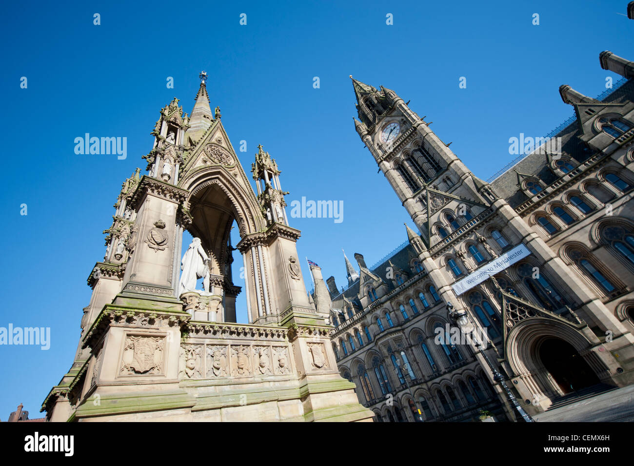 The Albert Memorial in Albert Square outside the town hall in Manchester City Centre on a clear day. - Stock Image