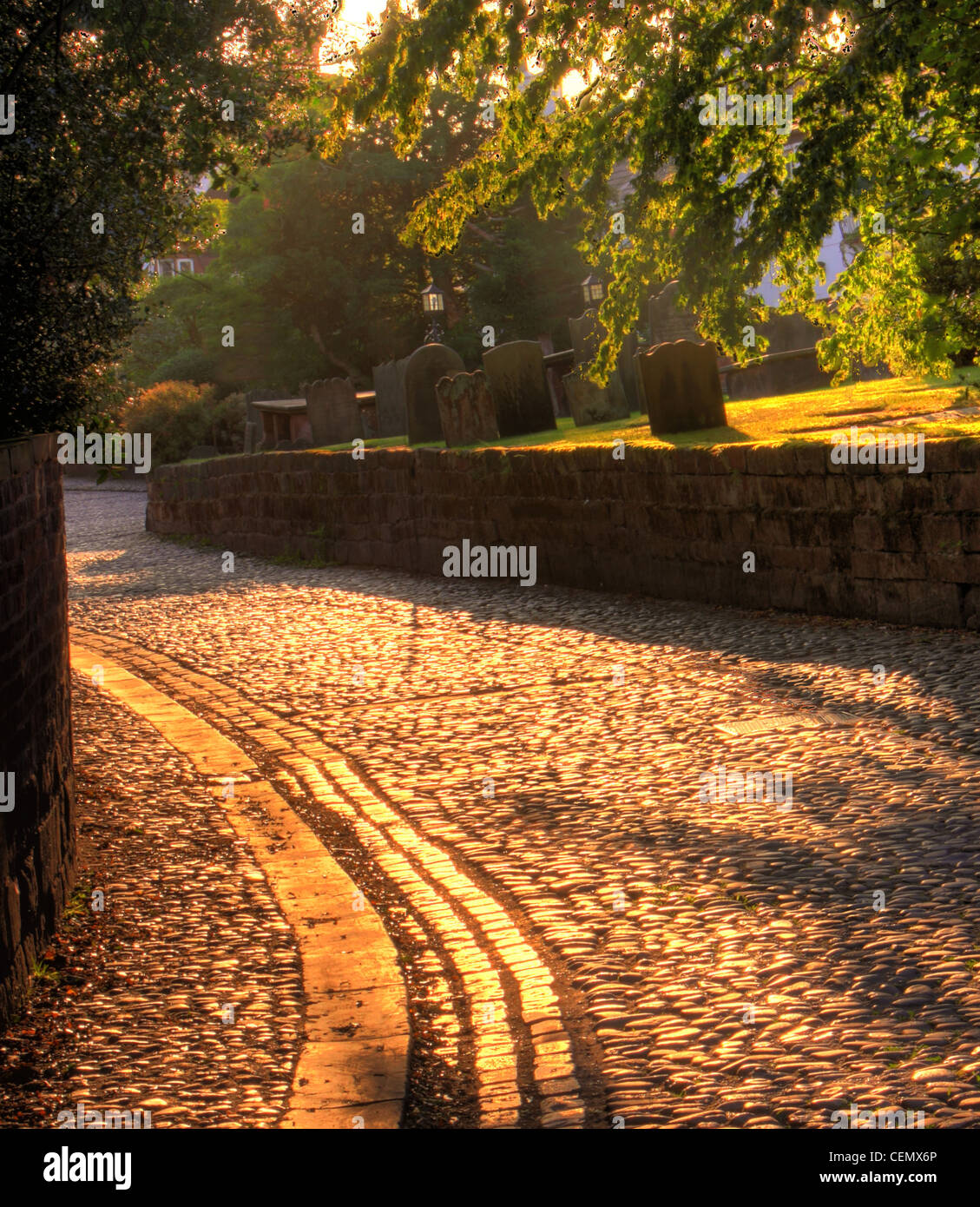 The cobbled area in Grappenhall Village, South Warrington at Sunset. (Church lane, adjacent to St Wilfrids parish Stock Photo