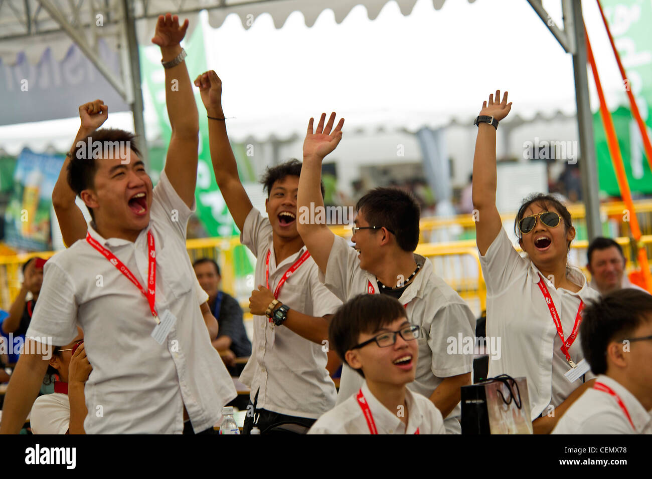 CHANGI, Singapore -- Aerospace and Avionics students from the Institute of Technical Education cheer and dance as - Stock Image