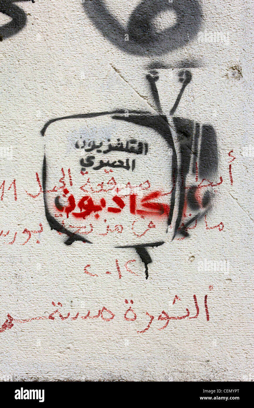graffiti on wall near Tahrir Square with image of television and writing: Egyptian television are liars - Stock Image