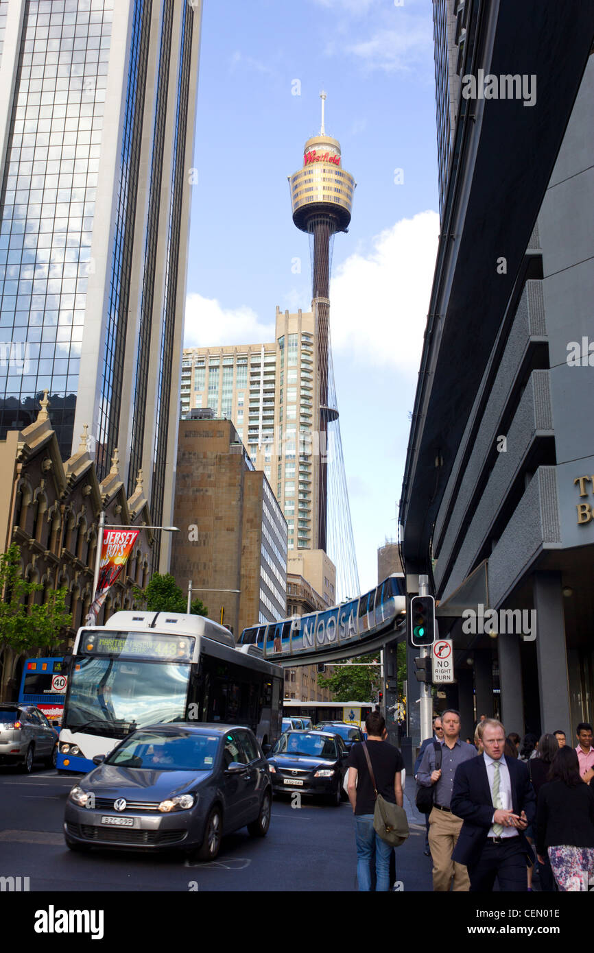 busy street in Sydney, Australia, with view of Sydney tower - Stock Image