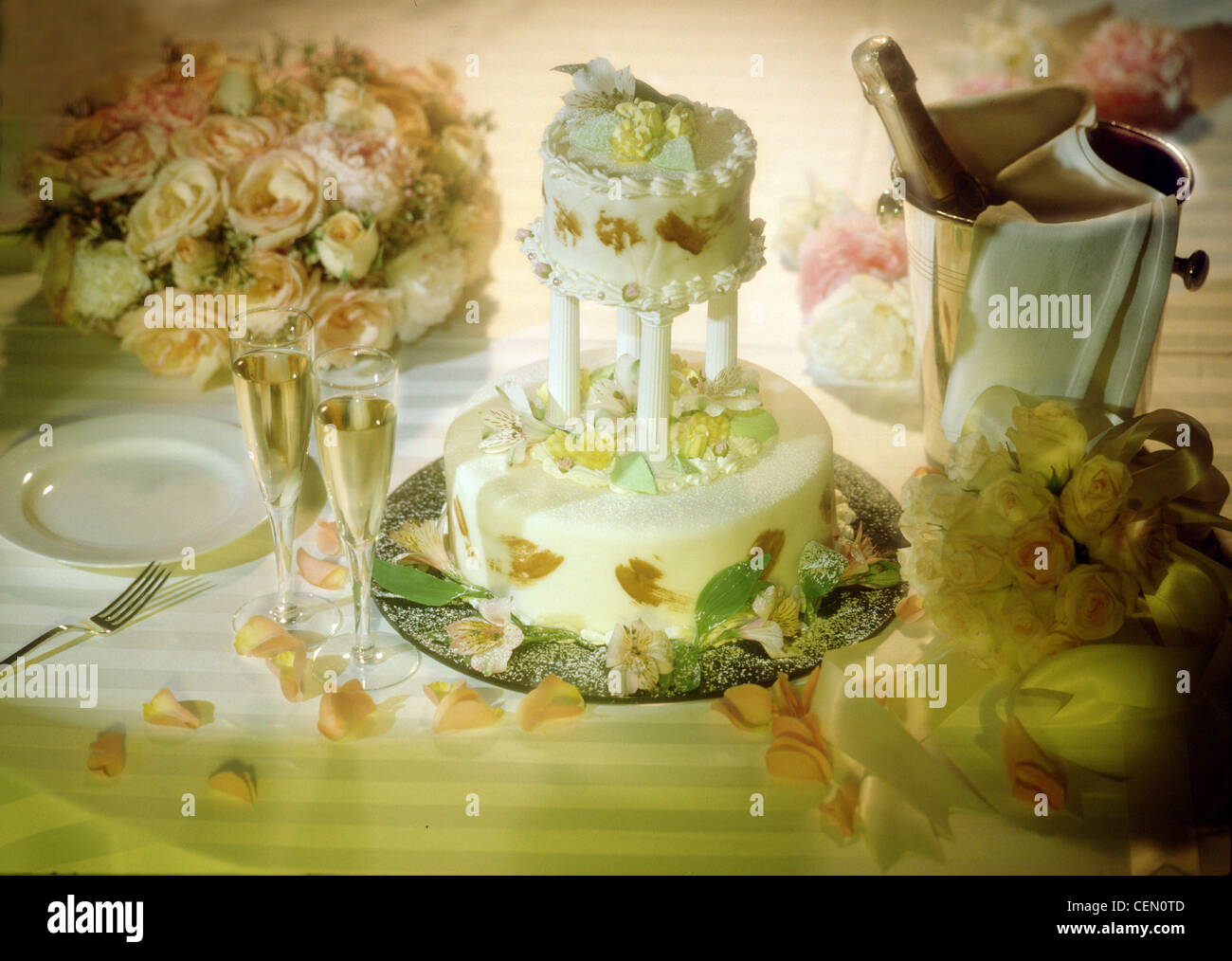 Two tier Wedding Cake with Champagne and table centerpiece of roses ...