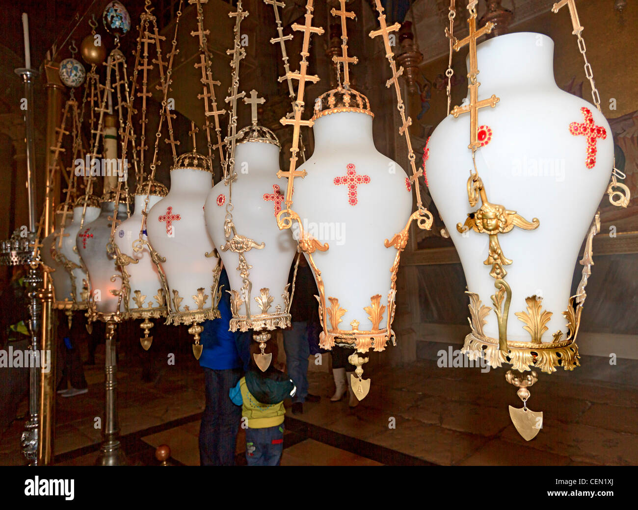 Lanterns above the Stone of Unction in the Church of the Holy Sepulchre, Old City Jerusalem, Israel Stock Photo