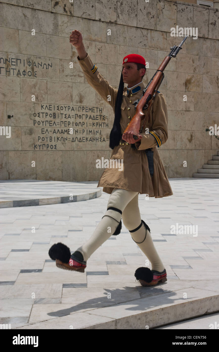 A member of the Evzones, or the Presidential Guard, guarding the Greek Tomb of the Unknown Soldier and the Presidential - Stock Image