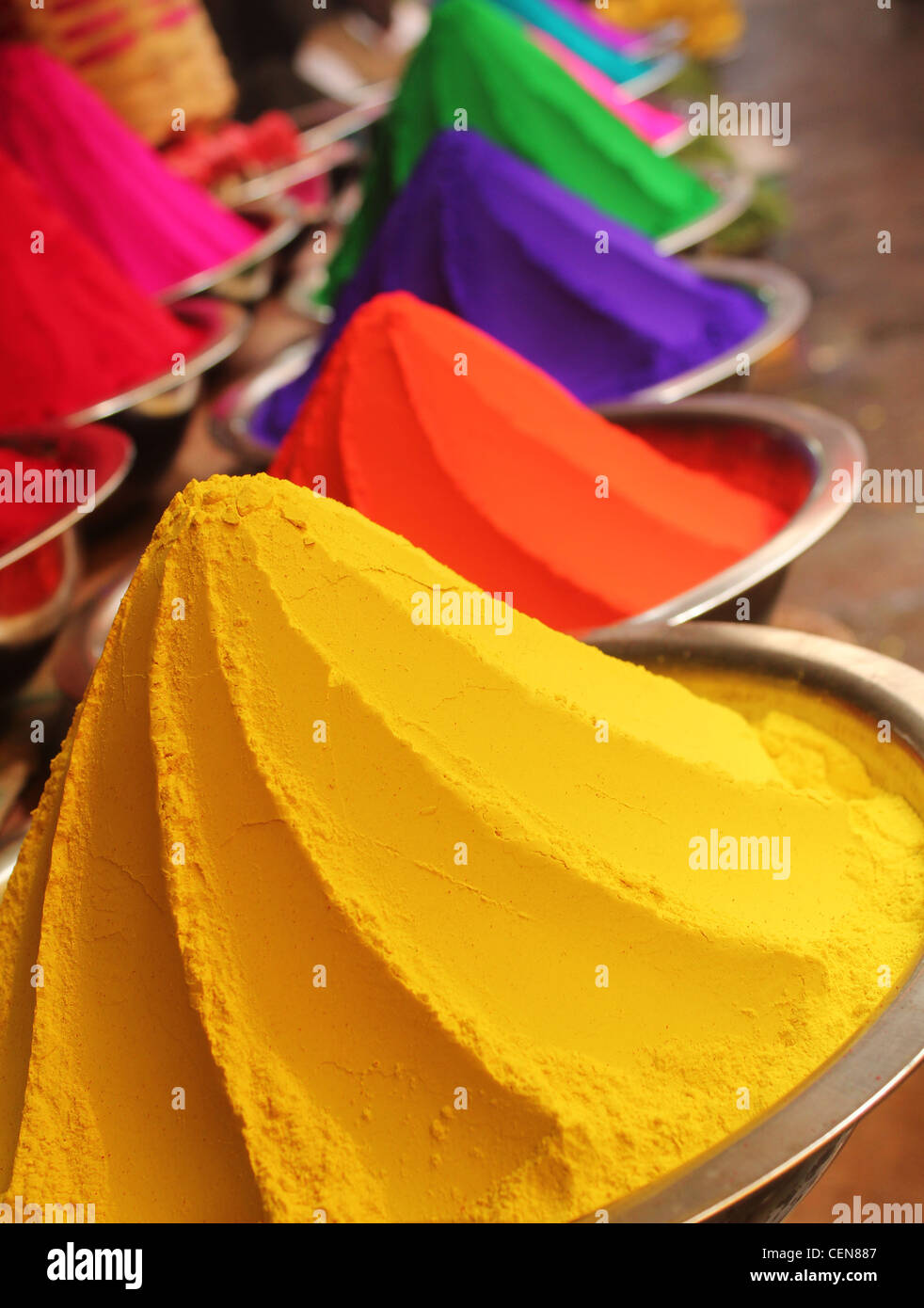 Colorful piles of powdered dyes used for holi festival on display in an indian shop at mysore - Stock Image