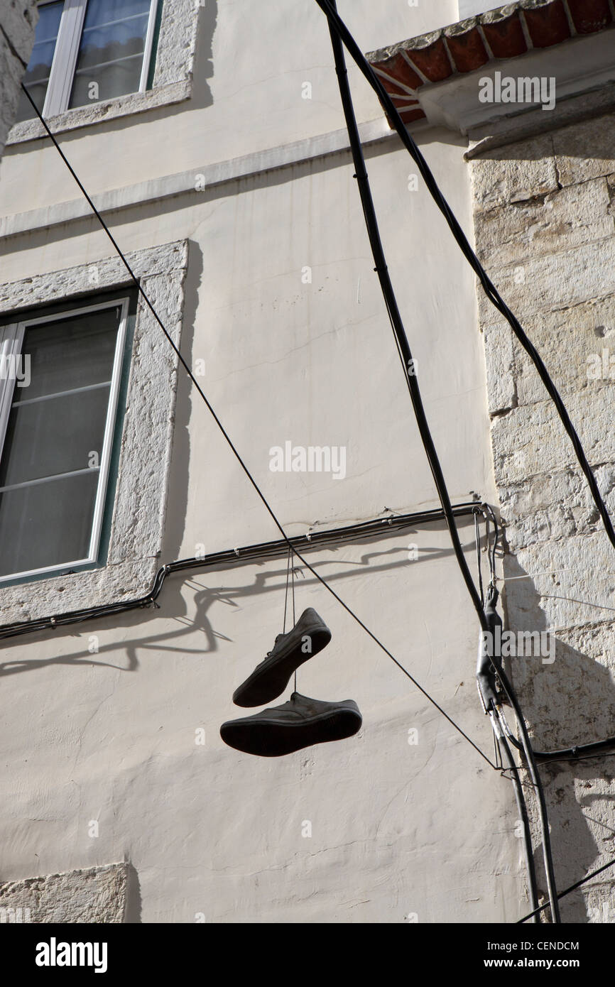 Shoefiti, youth culture rite of passage, central Lisbon, Portugal. - Stock Image