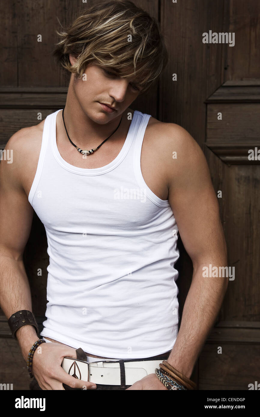 Male Fair Highlighted Hair Wearing A White Vest Necklace