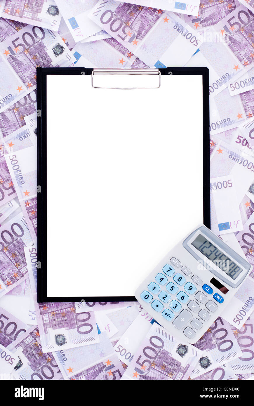 Clipboard and calculator surrounded by money - Stock Image
