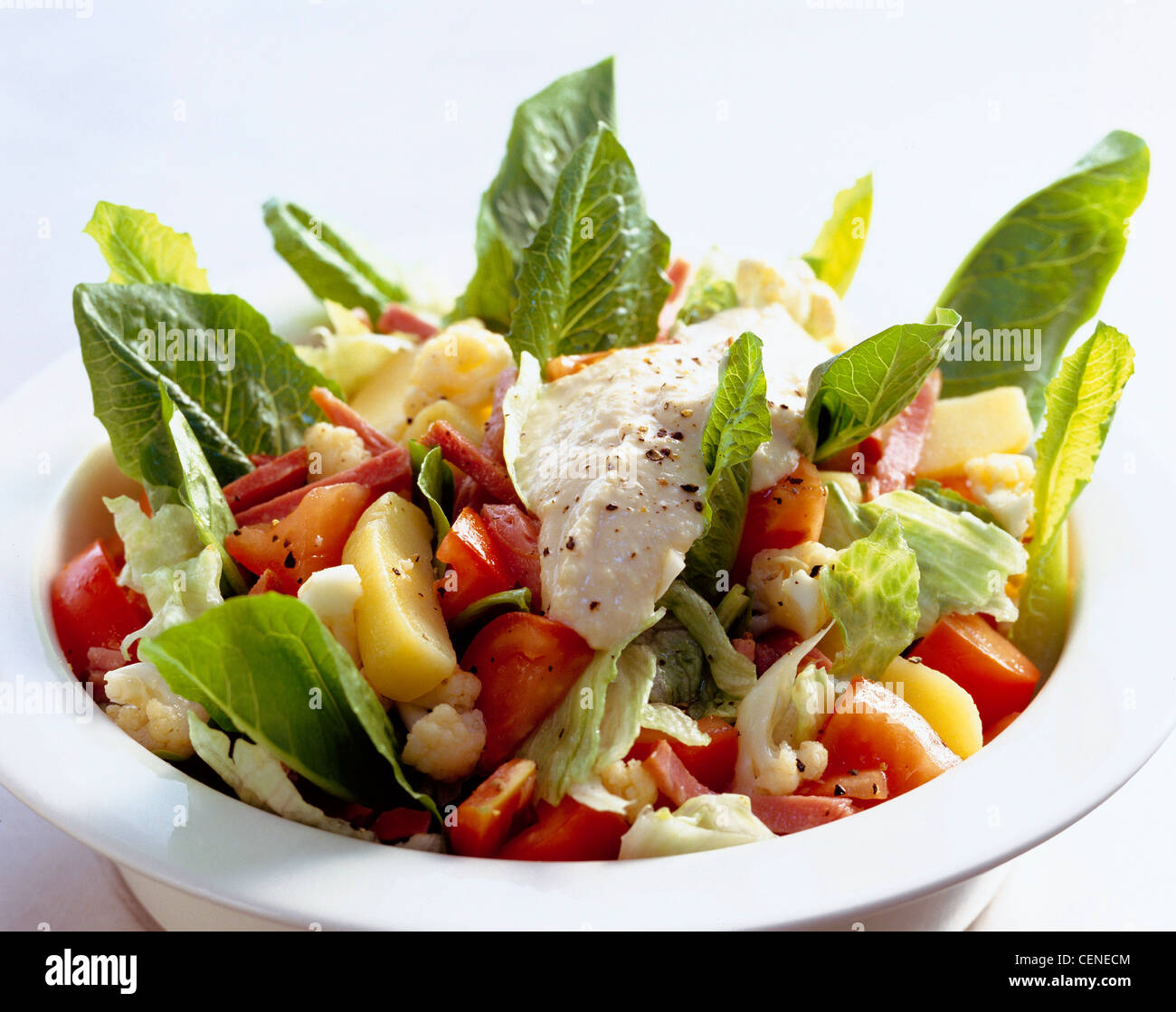 Midweek meals Ham salad hummus dressing, boiled potatoes, cauliflower, chopped tomatoes and romaine lettuce, in - Stock Image