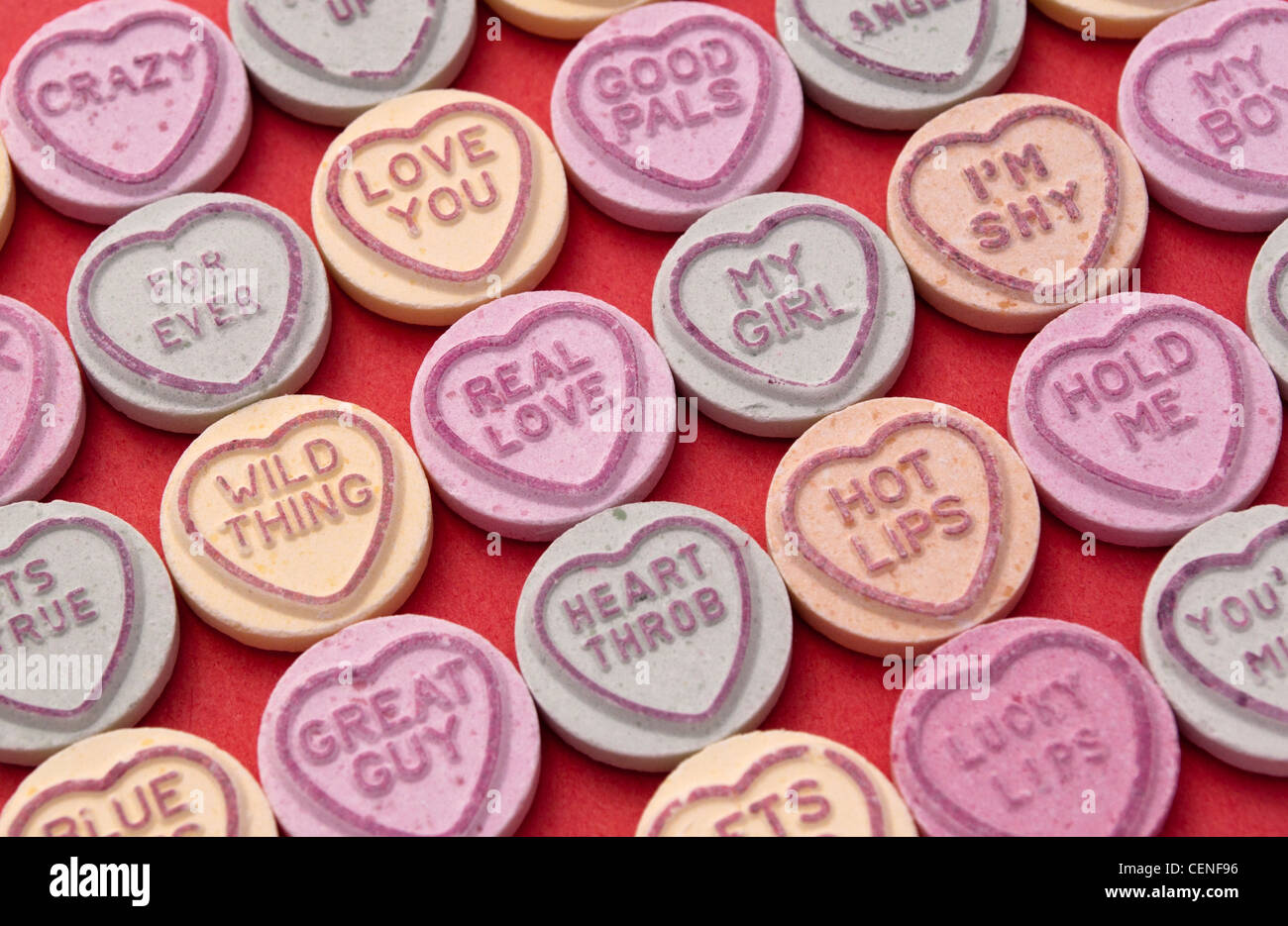 love heart candy sweets on a red background with a variety of stock