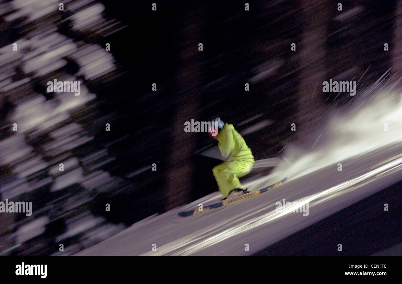 Freestyle ski jumper racing down the hill during the New Years Eve celebrations at Sun Peaks, Kamloops, BC, Canada, - Stock Image