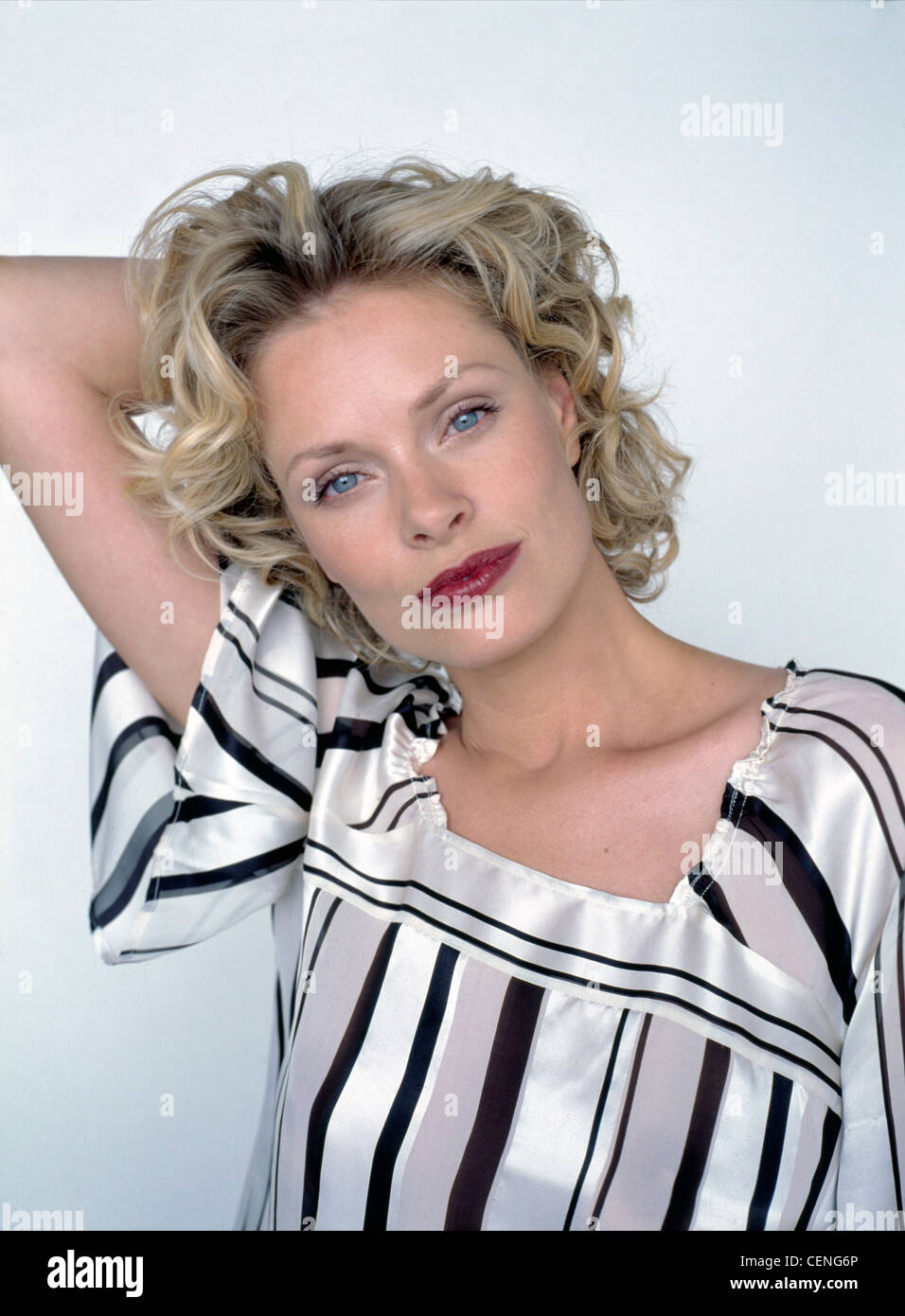 Hair Colours Female Short Curly Blonde Hair And Dark Red Lipstick Stock Photo Alamy