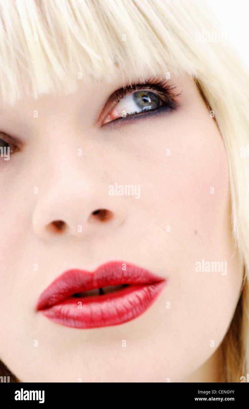 close up half face of female blonde hair fringe wearing smokey eye