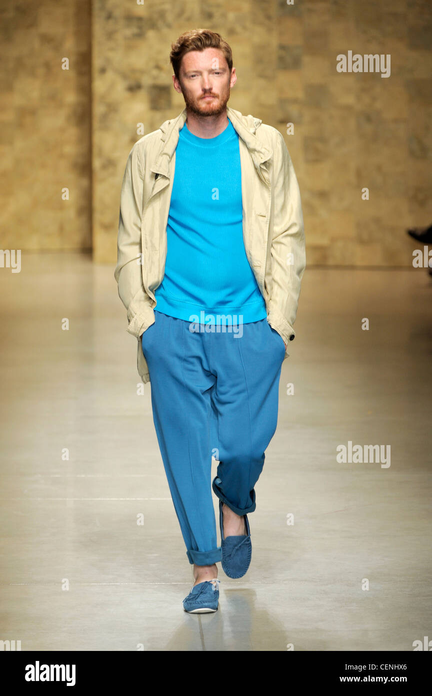 71cc99b3077 CP Company Milan Ready to Wear Spring Summer Cream jacket over blue t  shirt