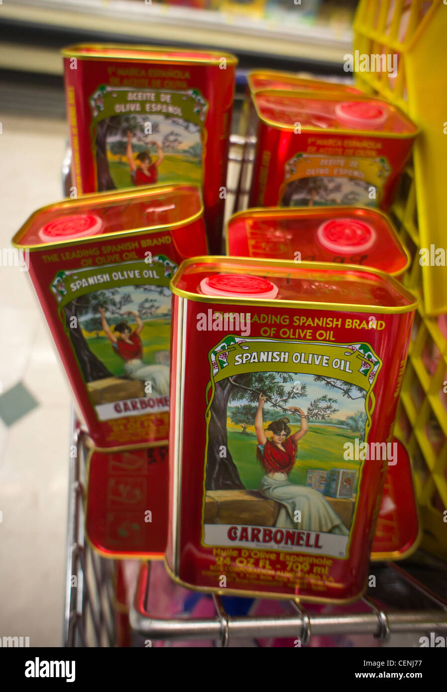 Cans of imported Spanish olive oil are seen on a supermarket shelf