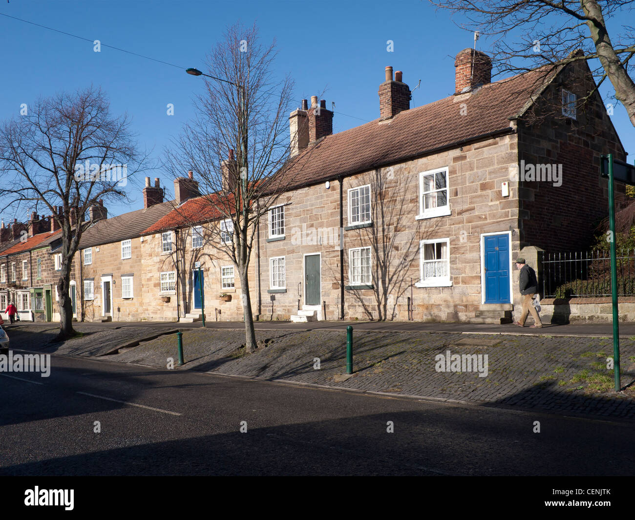 A row of substantial well built stone terraced houses in Guisborough North Yorkshire - Stock Image