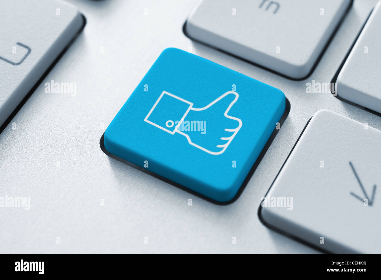 Thumb up like button on the keyboard. Toned Image. - Stock Image
