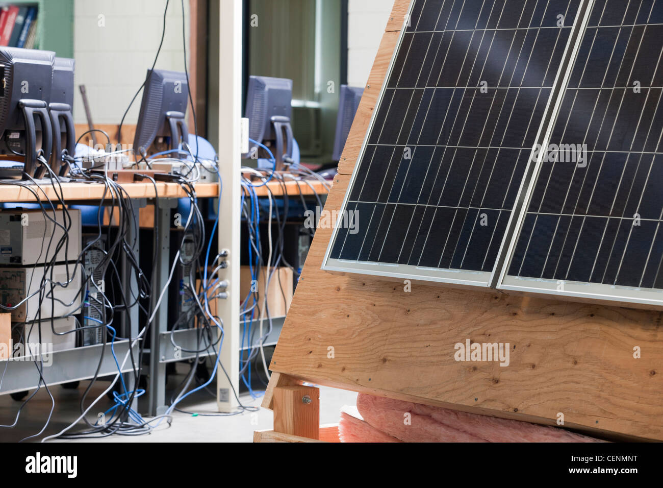 College engineering lab featuring computers and Photovoltaic panels for demonstration - Stock Image