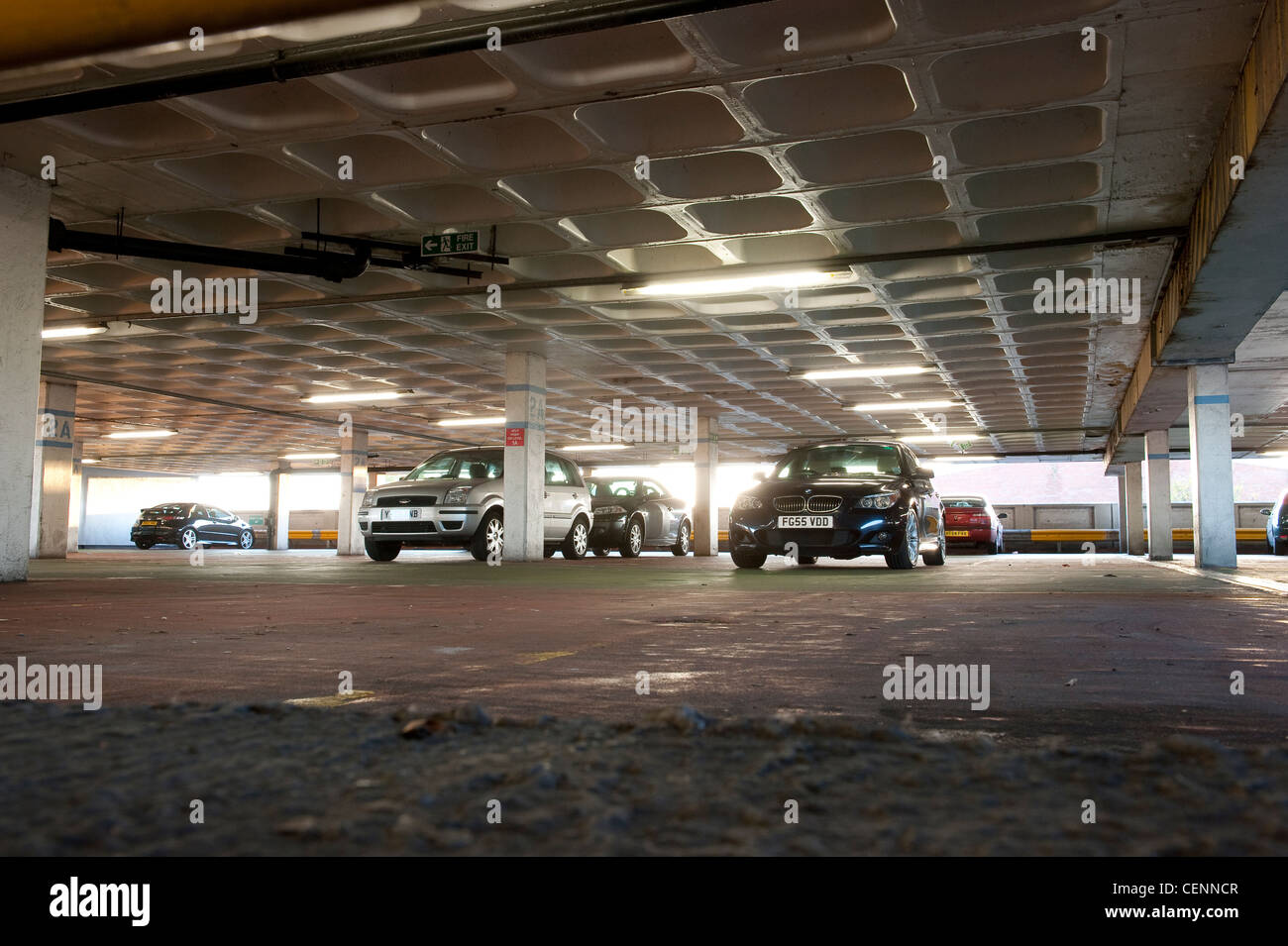 Cars parked in a multi-storey car park in England. - Stock Image
