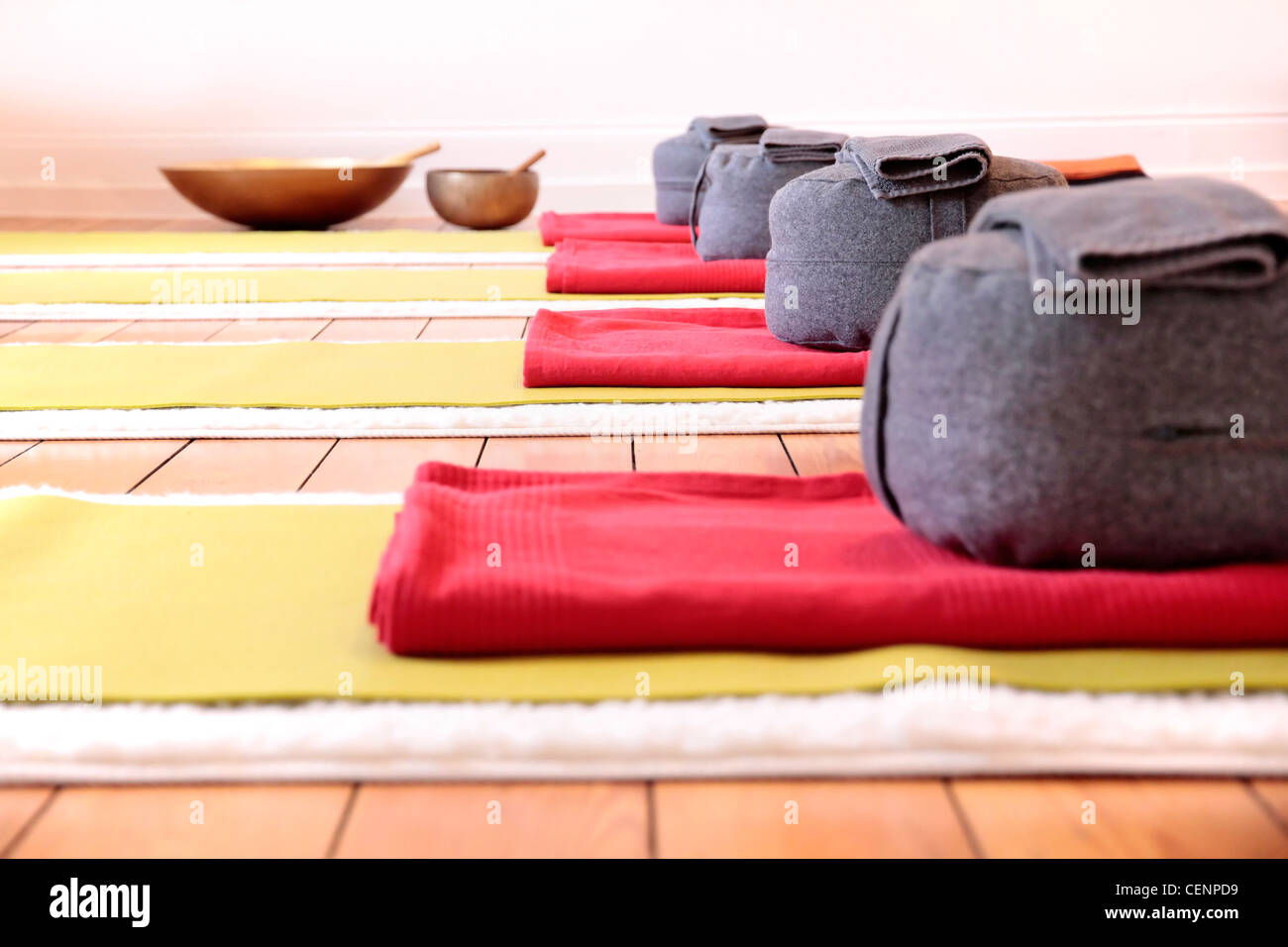 Close-up of yoga mats and yoga cushion in yoga studio - Stock Image
