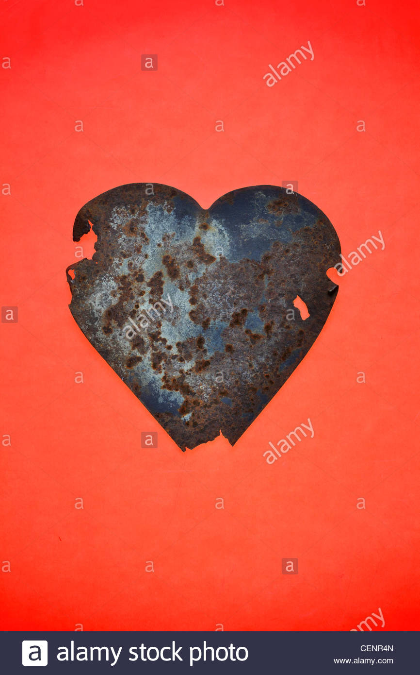 rusting metal red heart form still life - Stock Image