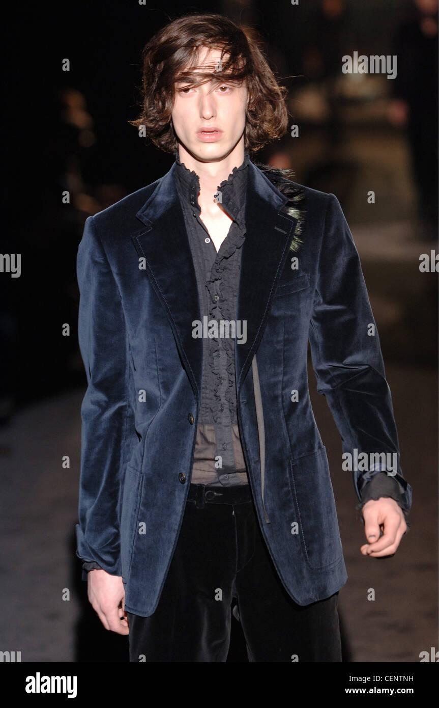 844075bea Gucci Menswear Milan A W Brunette male long hair wearing a navy blue velvet  blazer over a sheer grey ruffled button down shirt