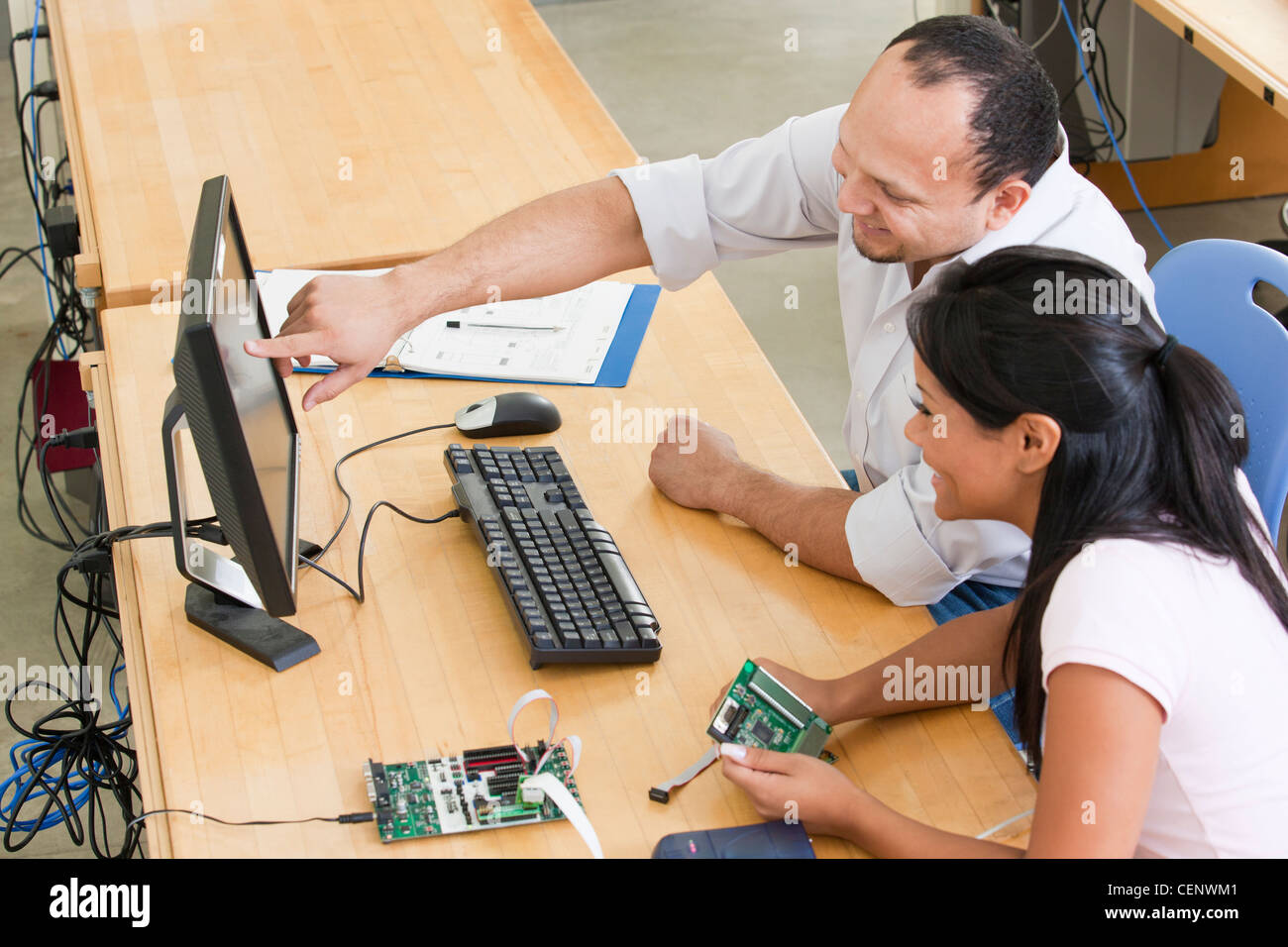Engineering students at computer using in-circuit emulator - Stock Image