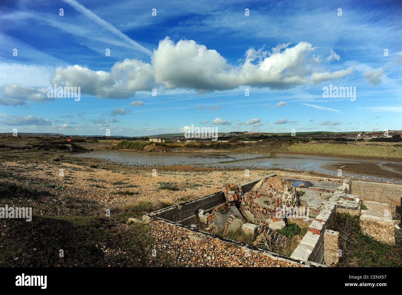 Tide Mills a derelict village abandoned in 1939, it consisted of a large water driven mill and numerous workers - Stock Image
