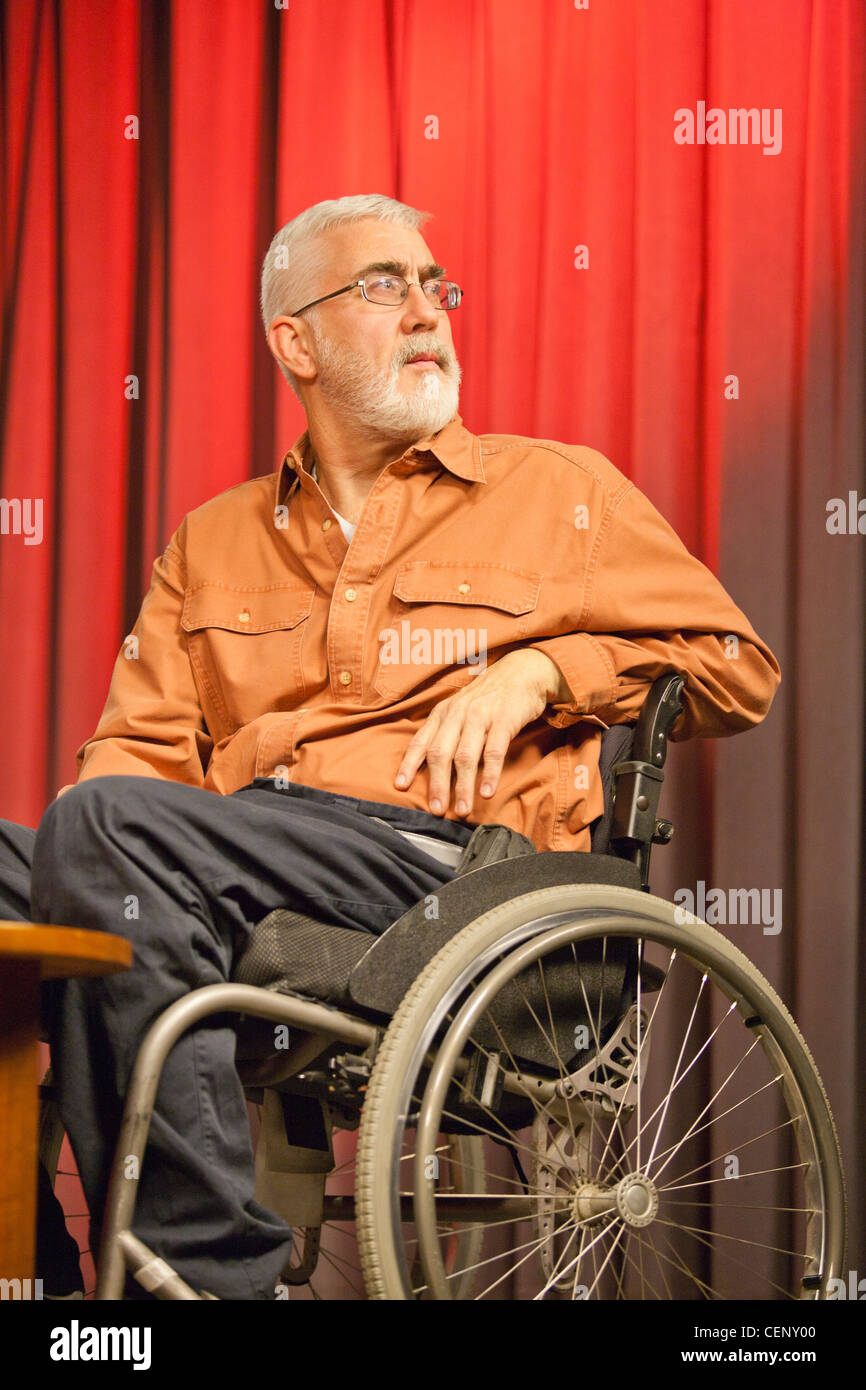 Man with muscular dystrophy and diabetes in a TV studio as a commentator - Stock Image