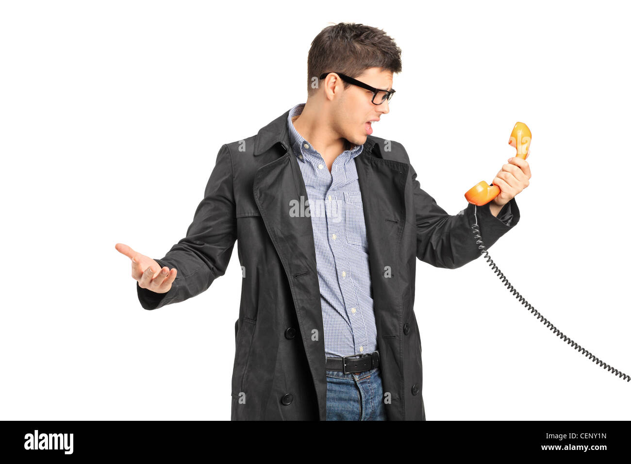 A surprised male holding a telephone tube isolated on white background Stock Photo